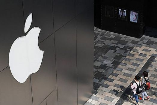 "(FILES) In this file photo taken on January 30, 2015 an iPhone held up in front of the Apple Inc. logo is photographed in Lille. .France will take legal action against Google and Apple for ""abusive business practices"", Finance Minister Bruno Le Maire said March 14, 2018. / AFP PHOTO / Philippe HUGUEN"