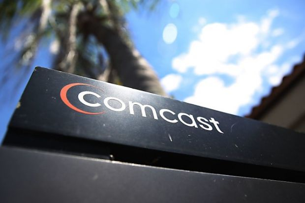 MIAMI, FL - APRIL 25: A Comcast sign is seen as the U.S. media group submitted a $30.7 billion bid for Sky on April 25, 2018 in Miami, Florida. Sky, a British TV provider, dropped its support for a lower offer from Rupert Murdoch's Twenty-First Century Fox after Comcast made its offer. Joe Raedle/Getty Images/AFP