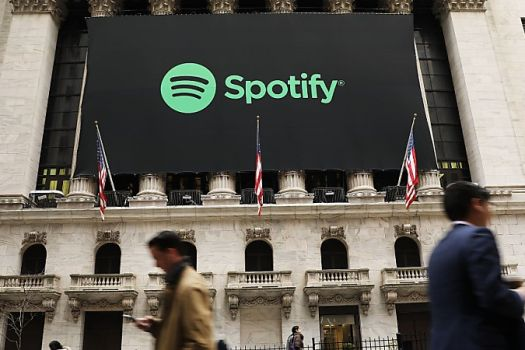 NEW YORK, NY - APRIL 03: The Spotify banner hangs from the New York Stock Exchange (NYSE) on the morning that the music streaming service begins trading shares at the NYSE on April 3, 2018 in New York City. Trading under the symbol SPOT, the Swedish company's losses grew to 1.235 billion euros ($1.507 billion) last year, its largest ever.   Spencer Platt/Getty Images/AFP